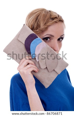 Beautiful young woman with luxury fashion handbag over white - stock photo