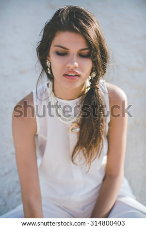 Beautiful young woman with makeup in fashion clothes - stock photo