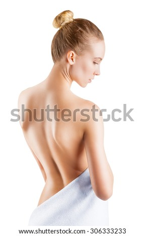 Beautiful young woman with naked back on a white background - stock photo