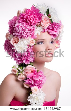 Beautiful young woman with peony flower - stock photo