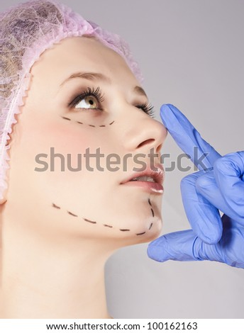 Beautiful young woman with perforation lines - stock photo