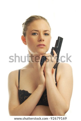 beautiful young woman with pistol - stock photo