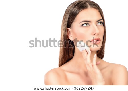 Beautiful young woman with pure fresh skin. Youth and beauty. Skincare, Spa. Isolated over white. - stock photo