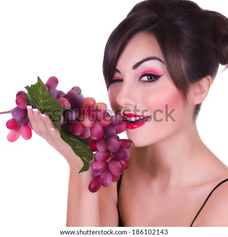 Beautiful young woman with red grape on white background - stock photo