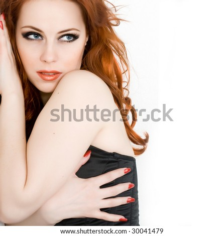 Beautiful young woman with red hair isolated - stock photo