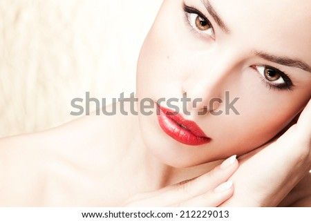 beautiful young woman with red lips, studio shot - stock photo