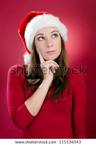 Beautiful young woman with santa hat thinking on a red background - stock photo