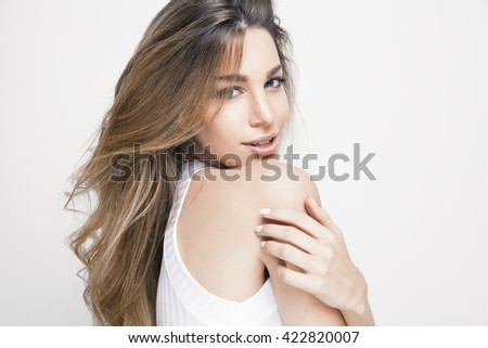 beautiful young woman with shiny hair and bright makeup. Lifestyle and cosmetics concept. studio shot, horizontal. - stock photo