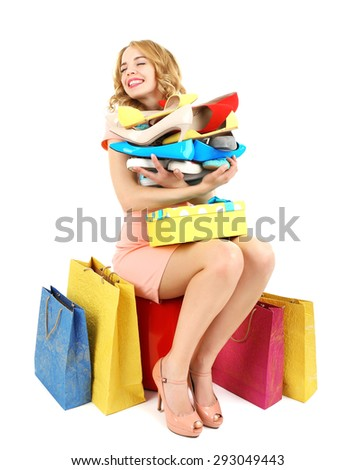Beautiful young woman with shopping bags and shoes isolated on white - stock photo