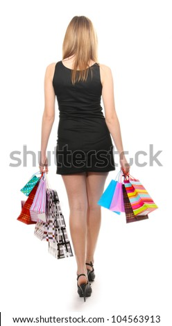 beautiful young woman with shopping bags isolated on white - stock photo