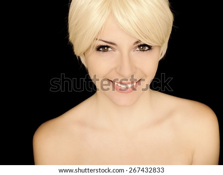 Beautiful young woman with short blond hair - stock photo