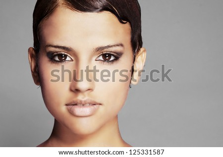Beautiful young woman with short hair style and pretty eyes. - stock photo
