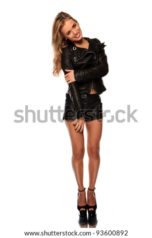Beautiful young woman with shorts and leather jacket - stock photo