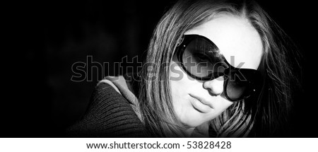 Beautiful young woman with sunglasses - stock photo