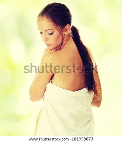 Beautiful young woman with towel, concept of spa, beauty, wellness salon,bath - stock photo