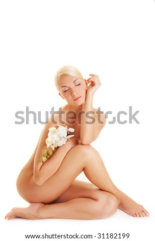Beautiful young woman with white orchid - stock photo