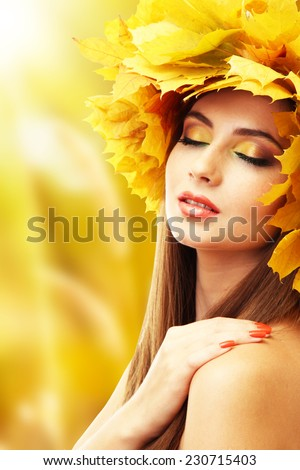 Beautiful young woman with yellow autumn wreath - stock photo