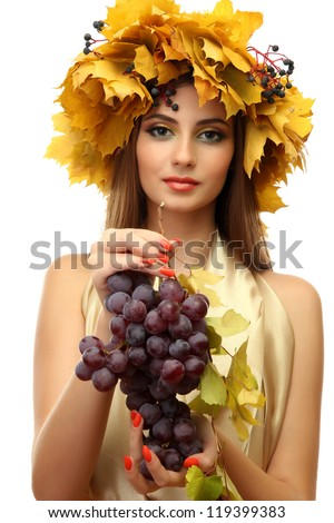beautiful young woman with yellow autumn wreath and grapes, isolated on white - stock photo