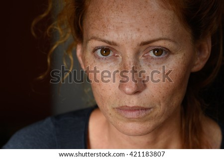 Beautiful young woman without make up black background close up   - stock photo