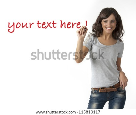 beautiful young woman writing on glass - stock photo