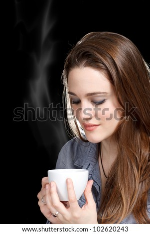 Beautiful Young Women Drinking a Cup of Coffee or Tea - stock photo