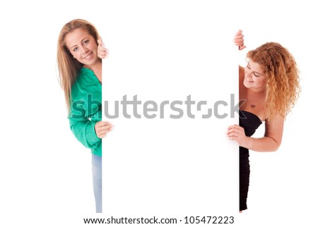 Beautiful young women holding a blank white board - stock photo
