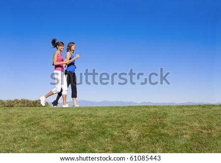 Beautiful Young Women Jogging & Fitness - stock photo