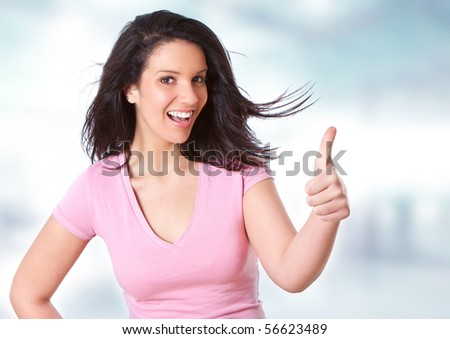 beautiful young women pointing with her thumb - stock photo