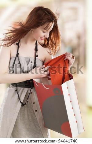 Beautiful young women shopping - stock photo