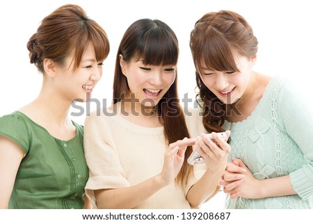Beautiful young women using a cellular - stock photo