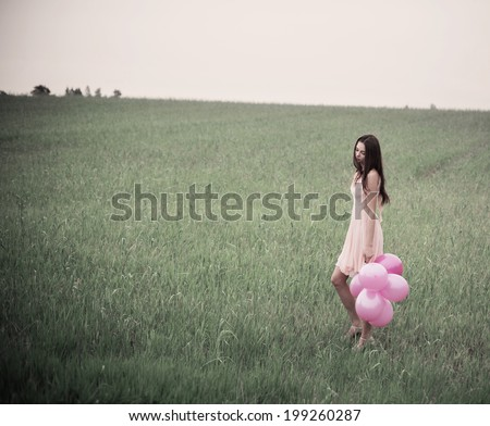 beautiful young women with pink balloons outdoor - stock photo