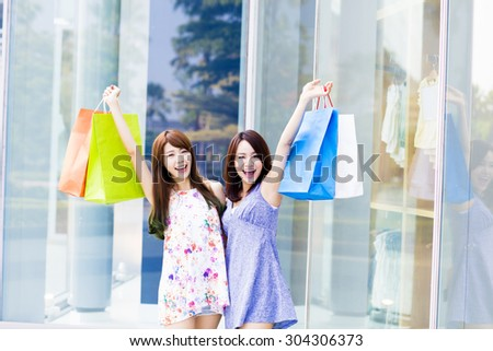 Beautiful Young Women with Shopping Bags - stock photo