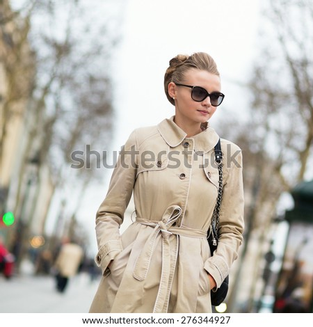 Beautiful yuong woman on Champs-Elysees in Paris - stock photo