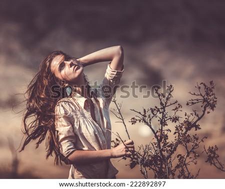 beautifull woman near the dry tree - stock photo