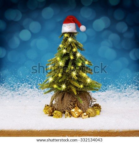 Beautifully decorated Christmas tree with many presents under it.Christmas tree  with gifts  and white  snow .Blue bokeh background. - stock photo