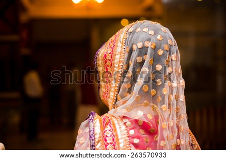 beautifully decorated Indian bride dress, Soft Focus. - stock photo