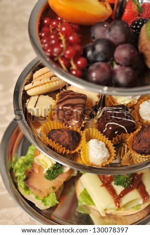 Beautifully decorated party setting with gourmet desserts and appetizers. - stock photo