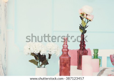 Beautifully decorated table adorned with multicolored flowers - stock photo