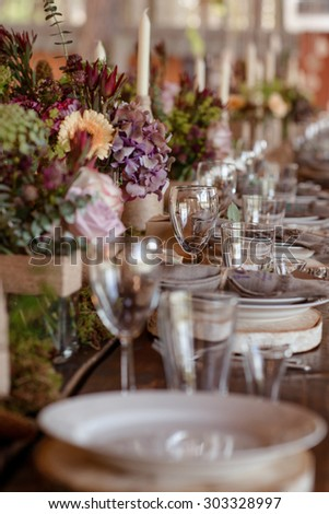 beautifully decorated wedding table in rustic style - stock photo