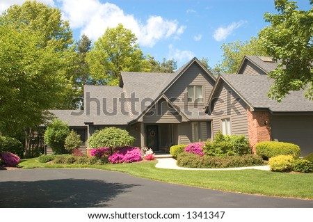 Beautifully landscaped new home. Just one of many new home or house photos in my gallery. - stock photo