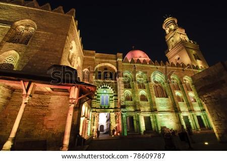 Beautifully lit Islamic Cairo at night - stock photo