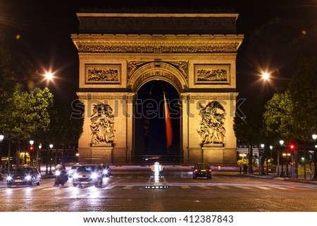 Beautifully lit Triumph Arch at night in Paris, France - stock photo