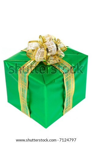 Beautifully packed gift. The white background isolated - stock photo