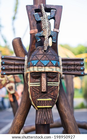 Beautifully painted Totem Pole in British Columbia, Canada isolated on white - stock photo