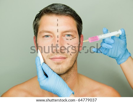 Beautifying a male with an injection - stock photo