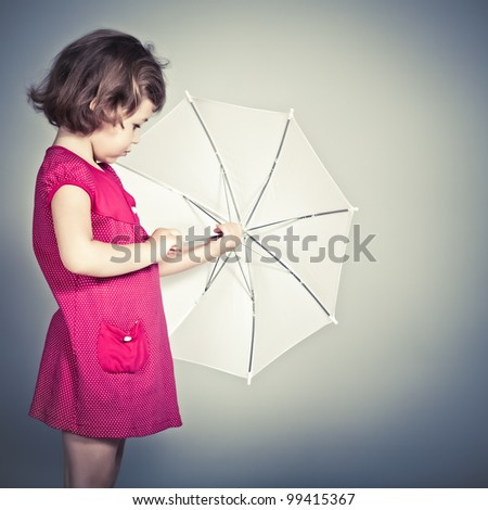 beauty a little girl with umbrella - stock photo