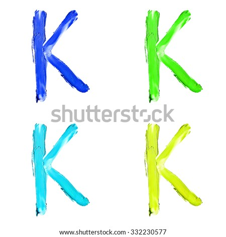 """Beauty alphabet set - blue, green and yellow dye letters isolated on white background. """"K"""" letter. - stock photo"""