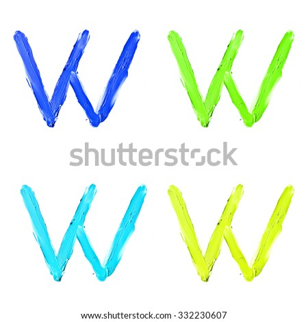 """Beauty alphabet set - blue, green and yellow dye letters isolated on white background. """"W"""" letter. - stock photo"""