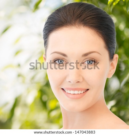 beauty and eco cosmetology concept - beautiful woman on nature - stock photo