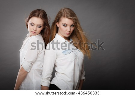 Beauty and fashion of woman. Attractive glamorous stunning girls. Portrait of gorgeous perfect styled trendy women photomodels posing together. - stock photo